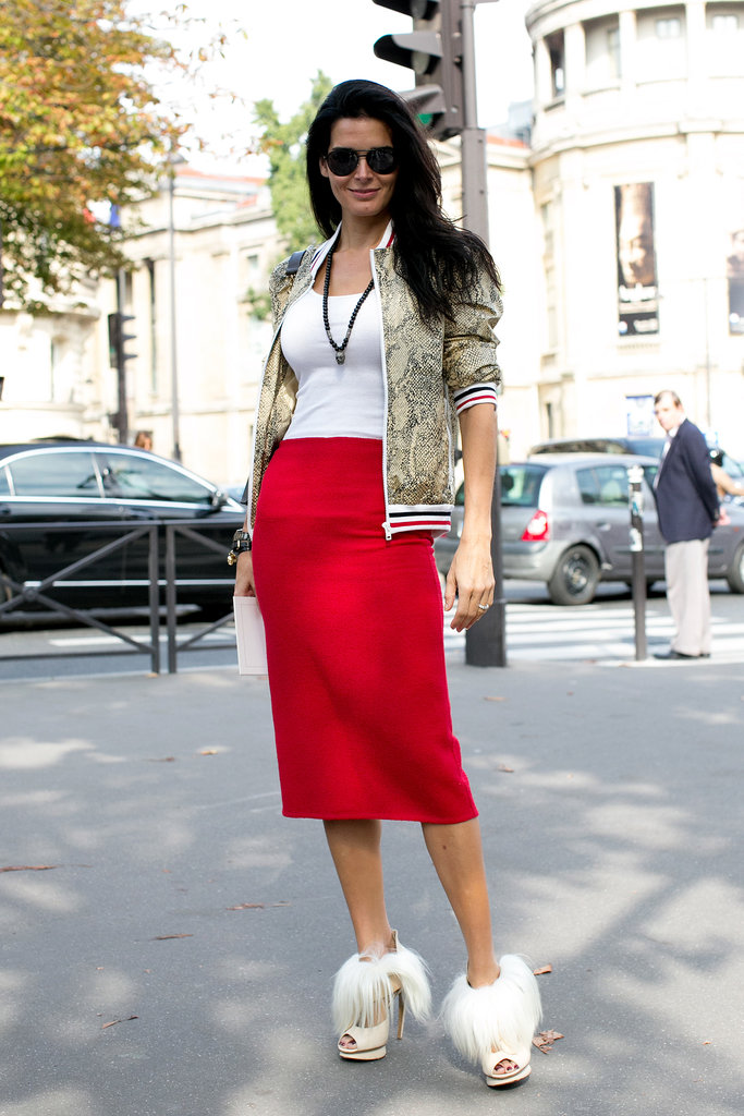 Angie Harmon put her most fashionable foot forward in fuzzy platform sandals, a red pencil skirt, and an animal-print bomber jacket during Paris Fashion Week.