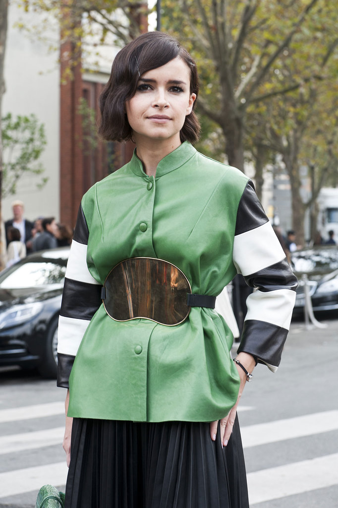 Miroslava Duma cinched the look with a statement belt.