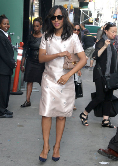 Kerry looked luxe in an embellished satin Tory Burch dress, a beige clutch, and navy Christian Louboutin pumps en route to Good Morning America.