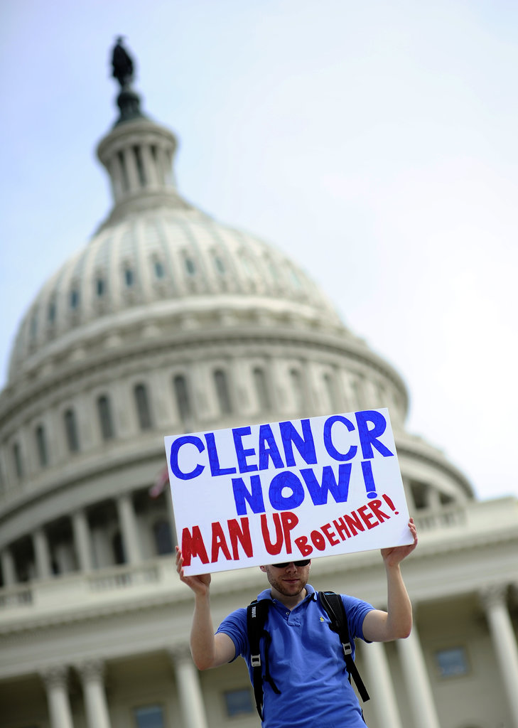 "A person at the DC demonstration held up a sign that read, ""Clean CR now! Man up, Boehner!"""