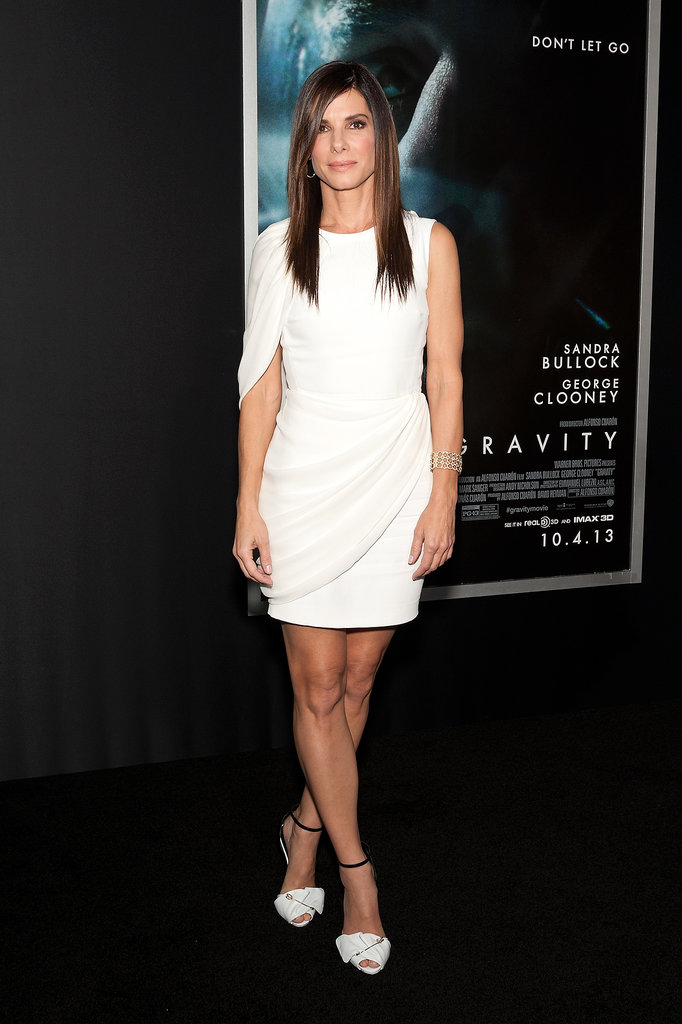 A round-the-world tour to promote her space flick Gravity has meant plenty of opportunities for Sandra Bullock to dazzle us. Most recently, we loved the draping of this white Giambattista Valli frock.