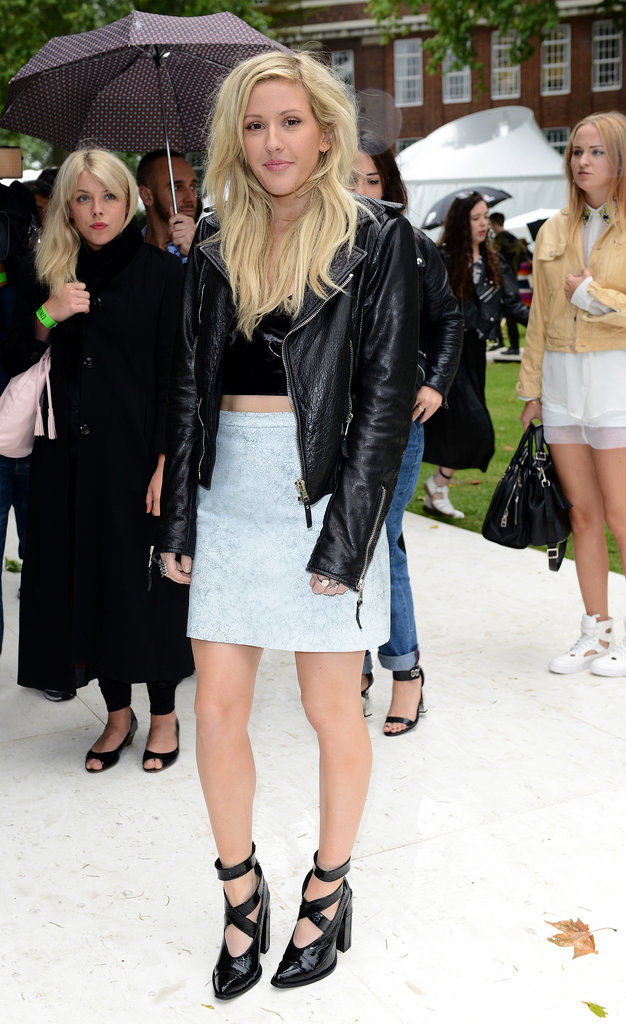 Ellie Goulding's Topshop miniskirt added a feminine flair to her black leather biker jacket, Topshop crop top, and strappy Topshop shoes at the Topshop Unique fashion show in London.