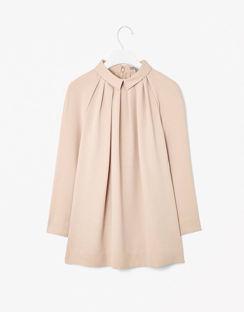 If you already own your fair share of white blouses, switch things up with a beige pick ($95).