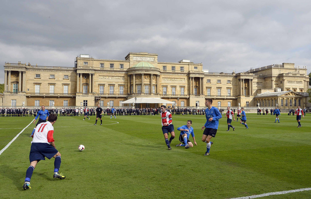 The match took place on the grounds of Buckingham Palace, which were transformed into a soccer field.