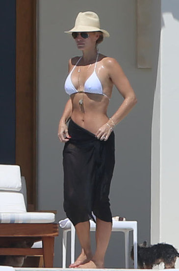 Molly Sims slipped into a white bikini while vacationing in Cabo San Lucas, Mexico, in October.