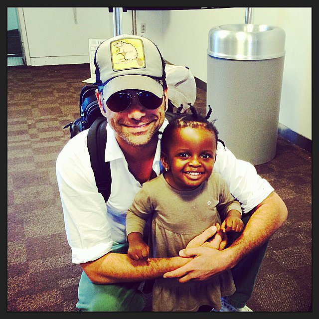 John Stamos posed with a tiny passenger at the airport. Source: Instagram user johnstamos
