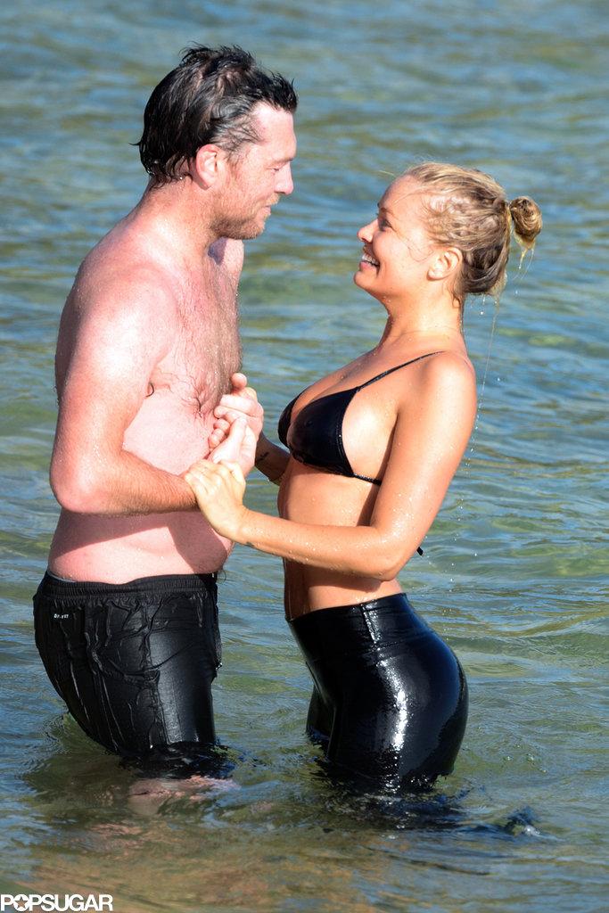 Sam Worthington stayed close to his new girlfriend, Lara Bingle.