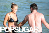 Sam Worthington and Lara Bingle were all smiles while playing in the water.