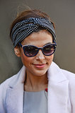 There are very few celebrities who love hair accessories more than Eva Mendes. She chose a polka-dot scarf twisted into a turban style to pair with her pretty pink palette for a more casual look.