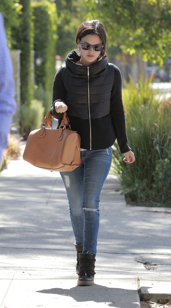 Rachel Bilson wore jeans and wedge sneakers.