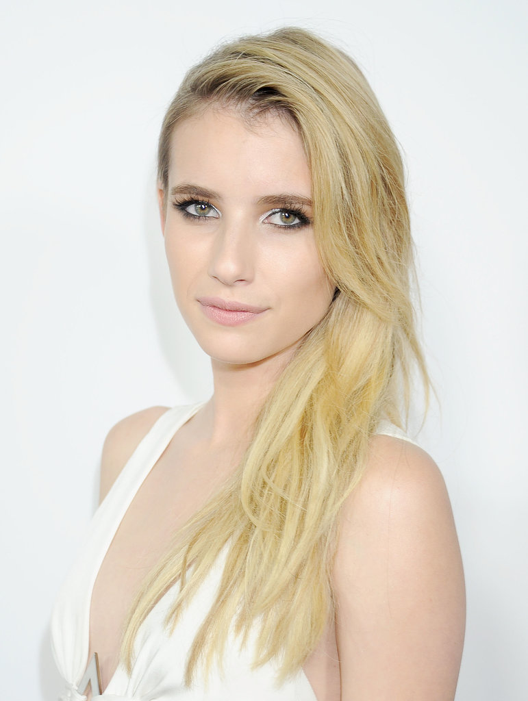 Emma Roberts has no reservations about trying the white eye shadow trend spotted on the runways. On the American Horror Story: Coven red carpet, she paired the pastel eye look with a nuetral pink lip. And is it us, or is she getting blonder?