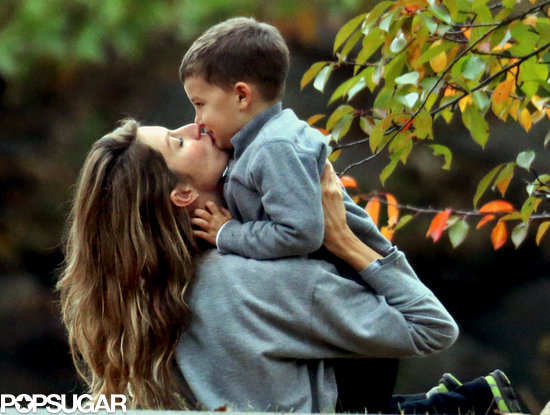 Gisele Bündchen planted a smooch on her son Benjamin Brady in Boston.