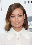 Olivia Wilde chose a light-on-color makeup look while attending the Her red carpet premiere, and her lob was subtly waved and swept off to the side.
