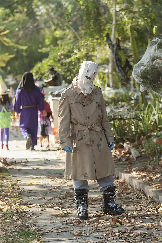 Trophy Wife Jackie (Michaela Watkins) dons a terrifying costume that looks eerily similar to Scarecrow from Batman Begins.