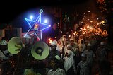 Muslim students in Indonesia carried lights and torches for a parade ahead of Eid al-Adha.