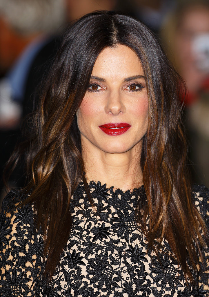 Sandra Bullock went for a glamourous look at the screening of Gravity, with deep red lips, shiny waves, and a healthy flush.