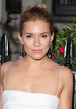 Sienna Miller stuck with a minimal beauty approach to pair with her simple white dress at the London Film Festival kick-off dinner.