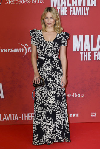 Dianna Agron wore a black and white floral Carolina Herrera dress from the brand's Resort 2014 collection, accessorized with a Jimmy Choo box clutch and Rupert Sanderson Resort 2014 shoes to the Germany premiere of The Family.