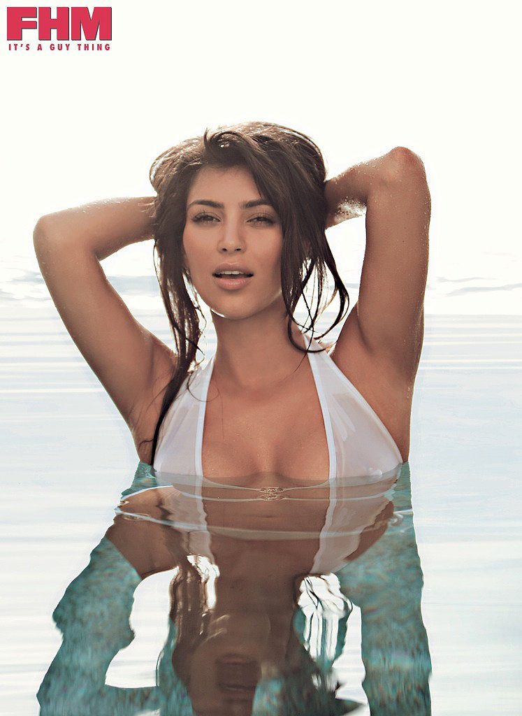 Kim kept her famous curves hidden under water while posing for FHM's October 2009 cover.