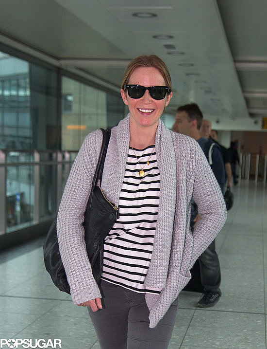 Emily Blunt landed in London with a smile on Sunday.