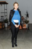 At the Vans Spring presentation, Jessica Stam added edge to her ensemble with a leather moto jacket and combat boots.