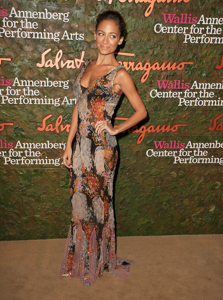 Nicole Richie posed with her hand on her hip in a sheer floral-print gown.