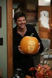 An adorable Ben (Adam Scott) shows off a carved pumpkin.