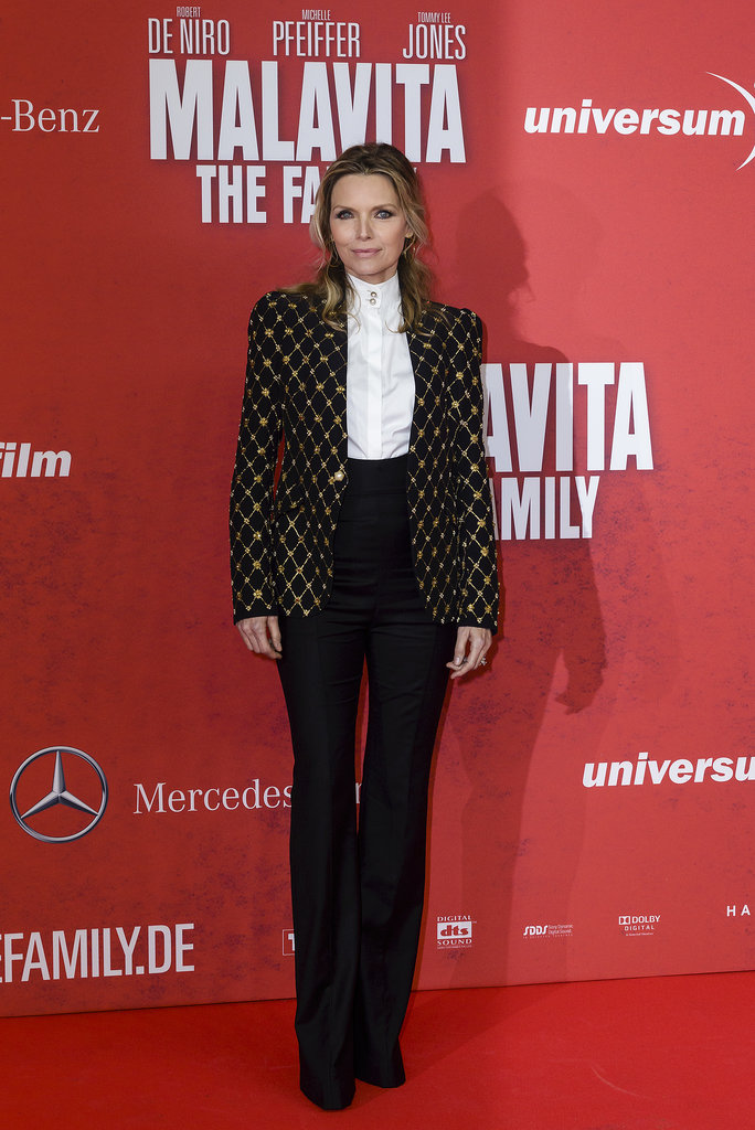 You don't need to wear a dress to suit the occasion. Case in point: Michelle Pfeiffer's rich embroidered jacket, button-down, and trousers by Alexander McQueen at the Berlin premiere of The Family.