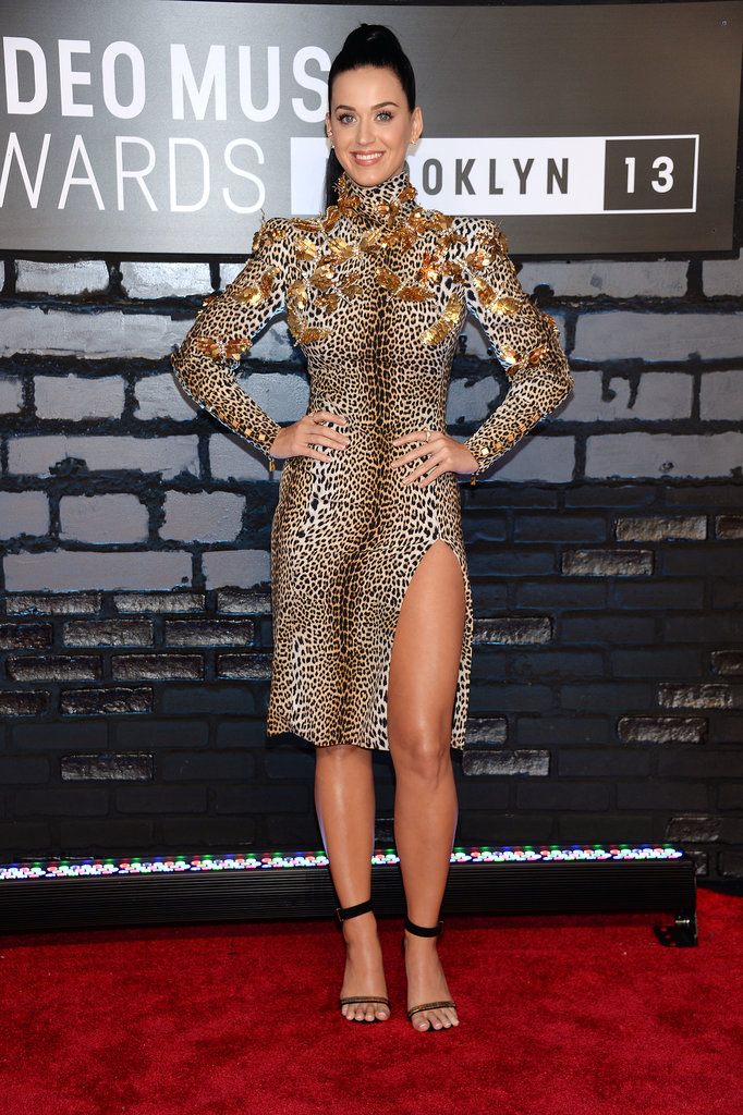 Katy roared — sorry, but we had to — in a leopard-print Emanuel Ungaro creation featuring gold appliqués and a thigh-high slit at the 2013 MTV Video Music Awards. She completed her wild style with Céline sandals and Anita Ko earrings.