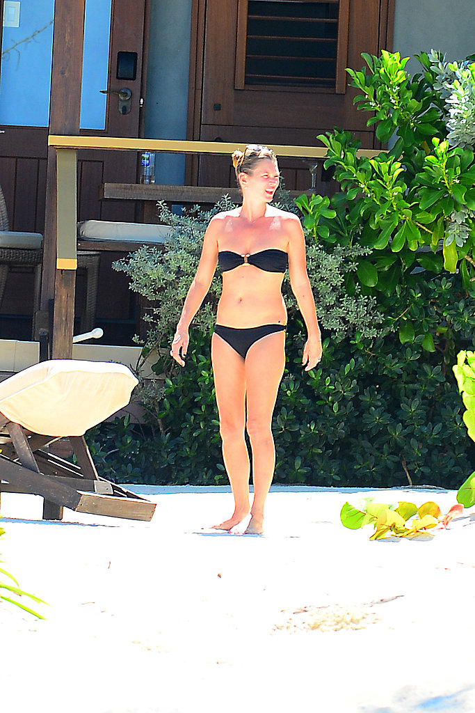 Kate Moss showed off her figure in a black bikini.
