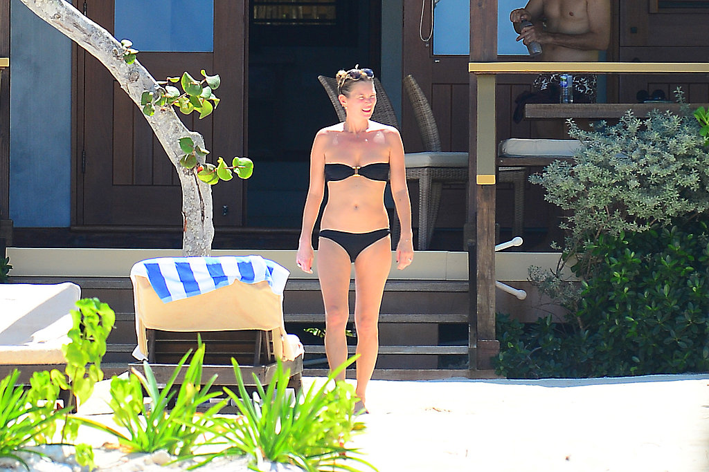 Kate Moss wore a black bikini while relaxing by the beach.