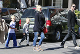 Keeping her look and her bump casual, Gwen rocked an oversize sweater and kicks during an outing with the whole fam.