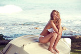 Lara Bingle modelled a white bikini in the campaign for her Lara Bingle For Cotton On Body swimwear line. Source: Cotton On
