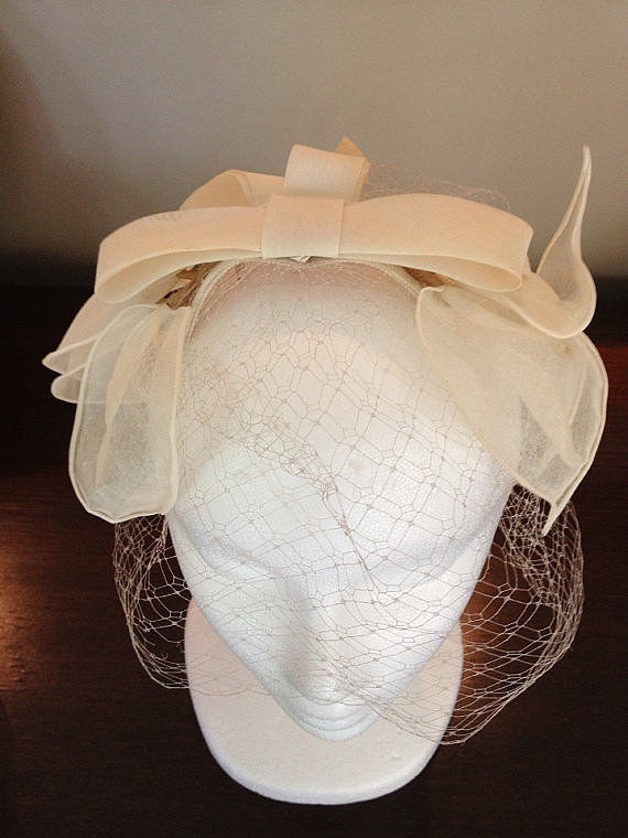 A delicate cage veil ($40) is something old that will take center stage on your big day.