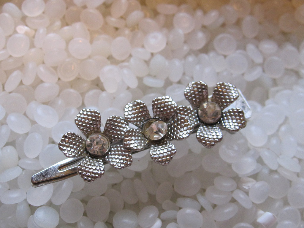 Need a pretty way to get your bangs out of your face? A vintage barrette ($12) could do the trick.