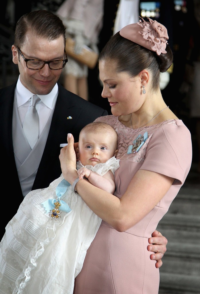 Prince Daniel and Crown Princess Victoria of Sweden held their royal baby, Princess Estelle, when she was christened at the Royal Palace on May 22, 2012, in Stockholm.