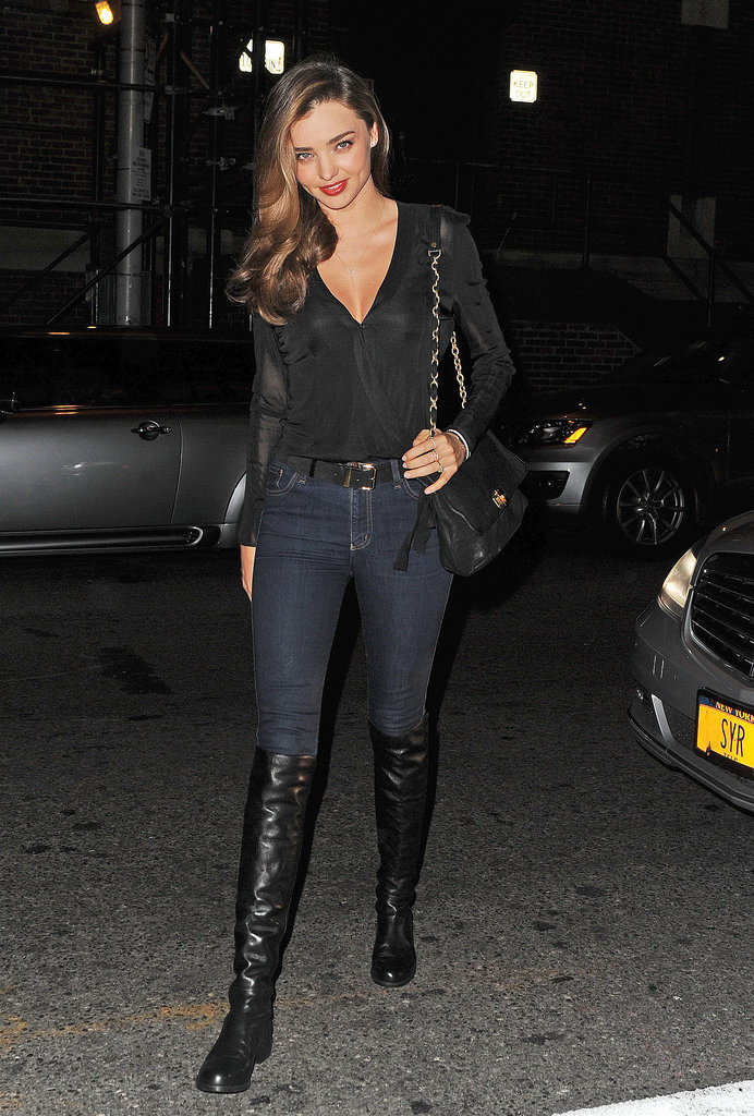 Miranda Kerr matched the NYC night in dark skinny denim and black leather over-the-knee boots.
