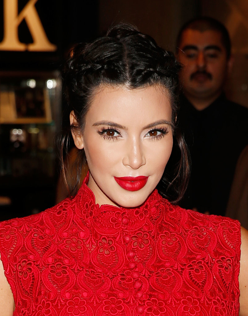 Donning a bright red lipstick and braids along her crown, Kim looked gorgeous at an appearance for the Kardashian Khaos store in Las Vegas.