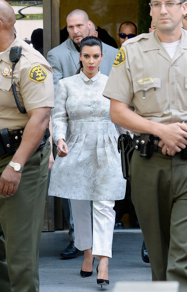 Kim said goodbye to one era and moved onto the next at her divorce hearing. For her day in court, the sexy star made a fittingly (and surprisingly!) demure turn in a floral topper and cropped white trousers.