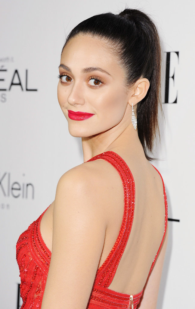 While ponytails were a popular trend of the night, we think Emmy Rossum's ultrahigh style deserves the top spot. She complemented the hair with a bright red lipstick and brown shimmering shadow.