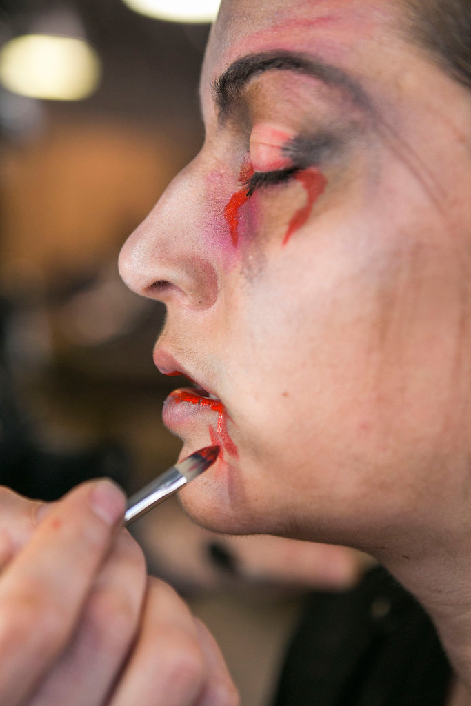 To make it look like you just had a meal, paint a little red acrylic on the inside of your lips, and add drips coming from the outer corners of your mouth.