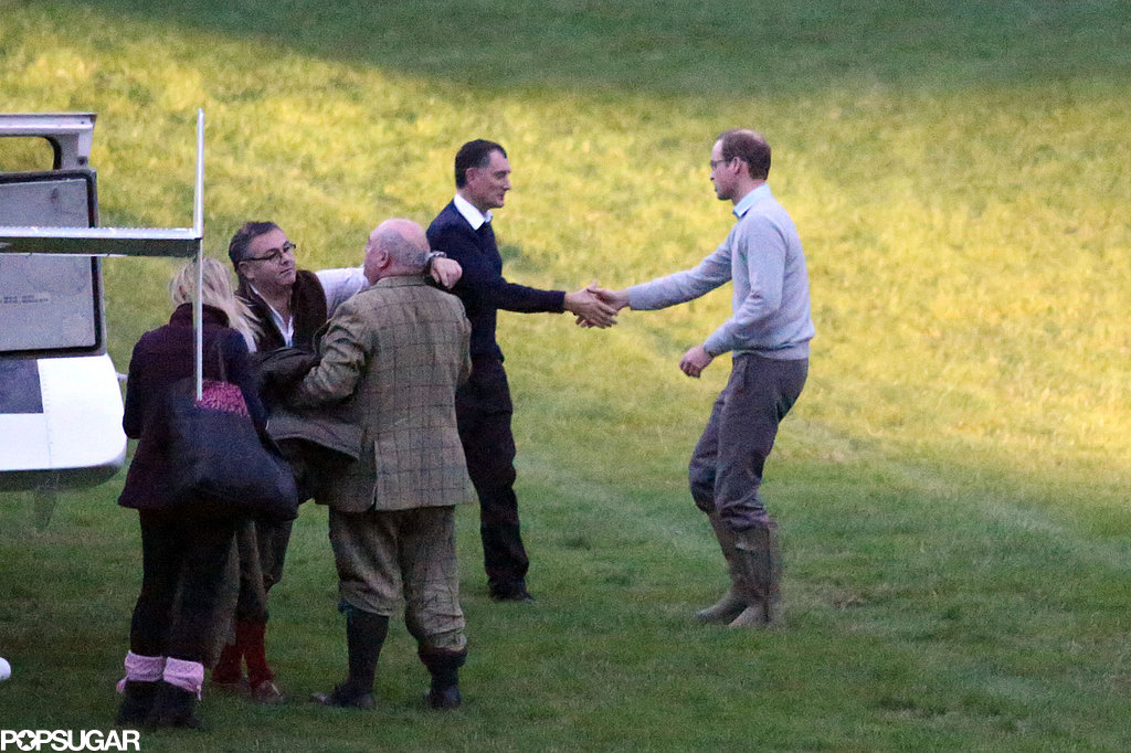 Prince William was greeted with a handshake after he landed back at Kensington Palace.