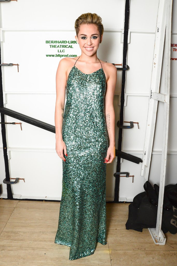 Miley Cyrus wore a glittering green dress from Marc Jacobs's Fall 2013 collection when she presented the designer with the evening's Superstar award.