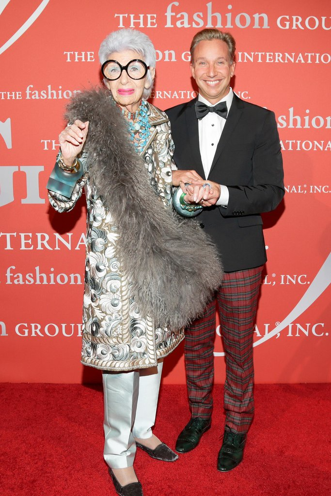Icon Iris Apfel showed up on the red carpet with a friend in spirited plaid trousers.