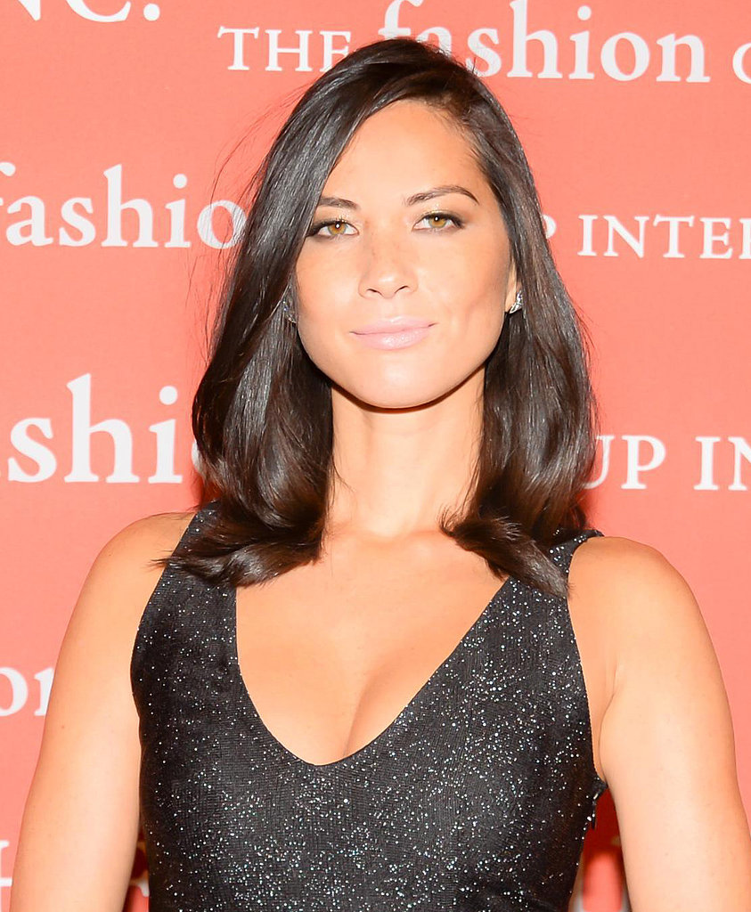 We're not quite sure how Olivia Munn maintains her bronzed complexion year-round, but her pastel pink lipstick really popped against her ever-present glow.