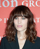 Alexa Chung hit the red carpet with her signature curls and bangs, and she highlighted her bright blue eyes with a touch of brown eye shadow.