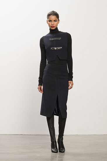Cropped Navy Vest With Snakeskin Trim ($395), Cashmere Black Turtleneck Sweater ($495), Center Slit Navy Pencil Skirt ($495), Erotic Dream Black Leather Thigh High Boot ($1,350) Photo courtesy of Tamara Mellon