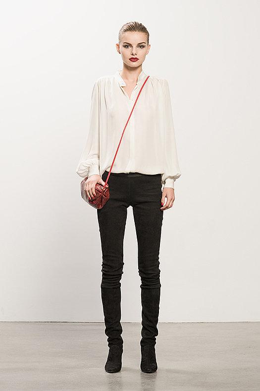 Georgette Cream Long Sleeve Blouse ($350), Sweet Revenge Black Suede Legging Boot ($2,395), Sunset Watersnake Red Cross Body Bag ($625) Photo courtesy of Tamara Mellon