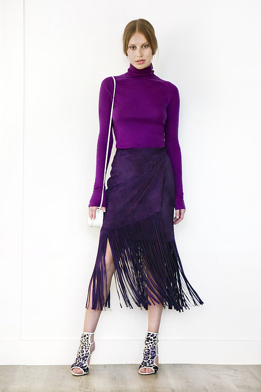 Turtleneck Cashmere Sweater ($495), Suede Fringe Skirt in Purple ($1,195), Trouble Maker Pony Open Toe Sandal Bootie in Grey Leopard ($750), Treasure Watersnake Small Cross Body Bag in Cream ($650) Photo courtesy of Tamara Mellon