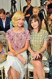 Sitting side by side, Caitlin Fitzgerald's pink lips and curls looked gorgeous alongside Lizzy Caplan's blowout and cat eye.